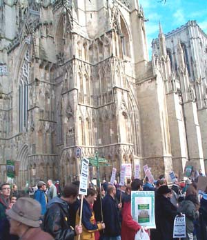 Demonstrators pass York Minster